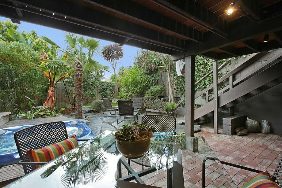 Above: The brick patio of 11 Wright St., in Bernal Heights includes an in-ground hot tub surrounded by tall trees and high fences. Photo: OpenHomesPhotography.com
