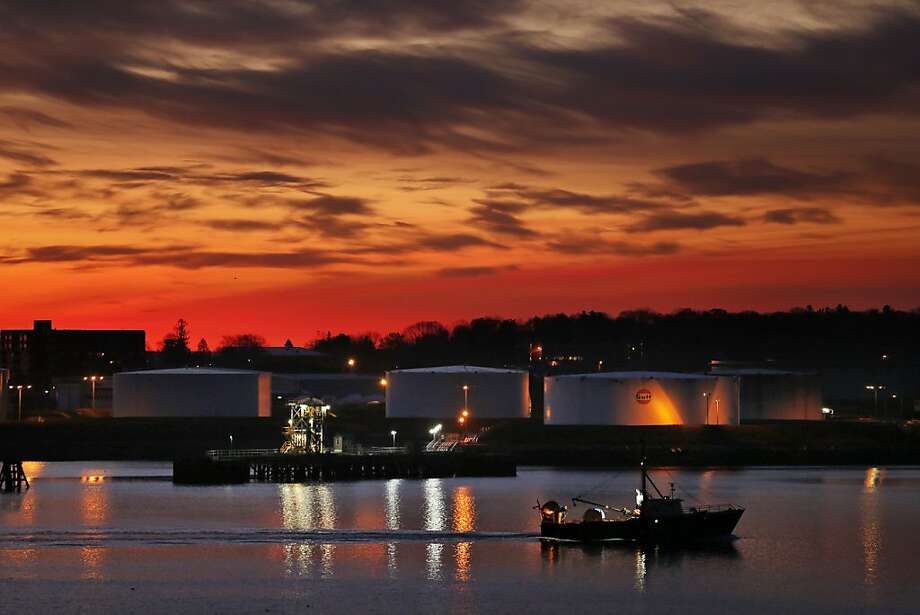 Thirty minutes before sunrise,the skies above Portland, Maine, are aflame with color as a fishing trawler heads out to   sea. Photo: Robert F. Bukaty, Associated Press