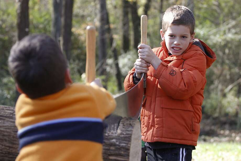 We're going to be in high school when we get done with this:Anderson Brown (foreground) and Robert Good saw a   log during Walker Farm Pioneer Days in Chattanooga, Tenn. Photo: Dan Henry, Associated Press