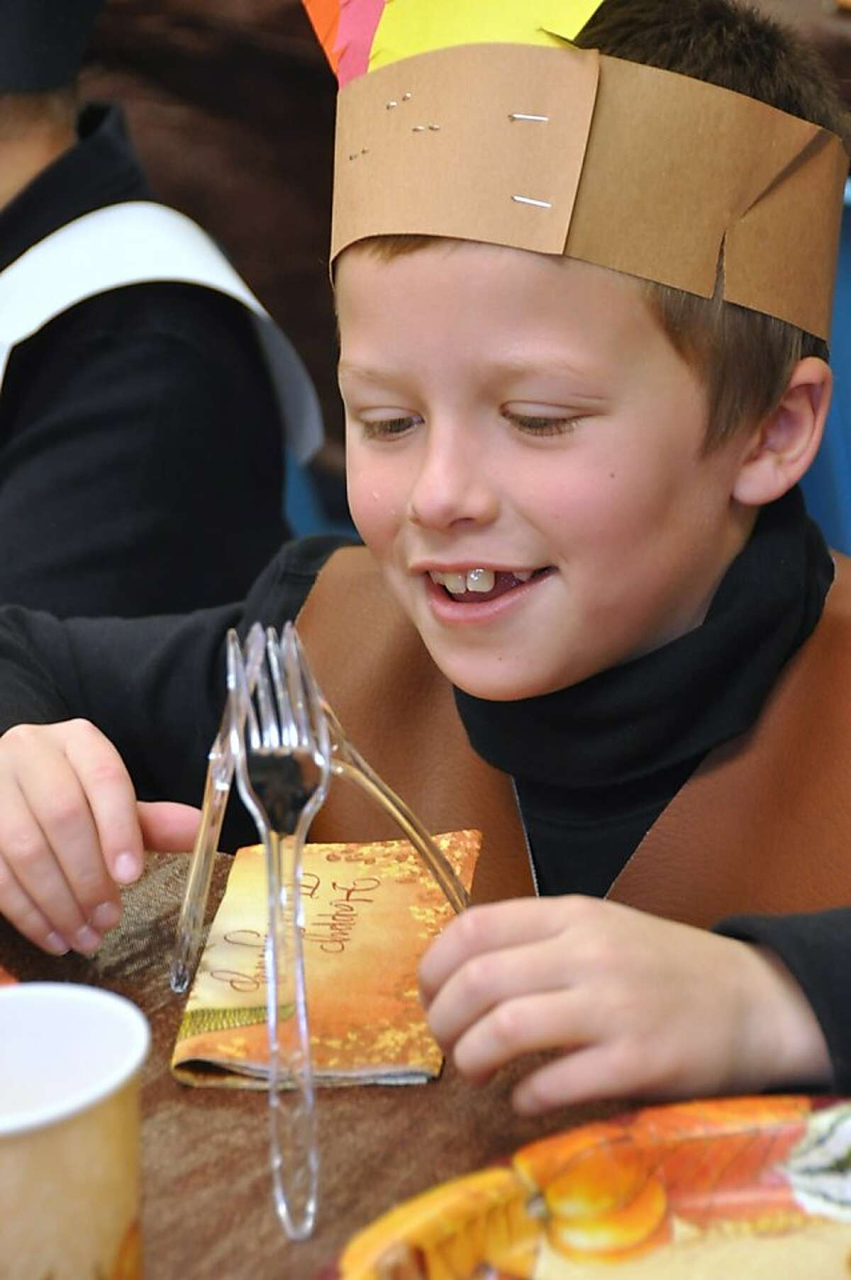 As pupils re-create the first Thanksgiving at Fairview Elementary School in Mountain Top, Pa., third-grader Chuckie Lake builds a napkin tepee with plastic utensils. Just like the Indians did during long-winded Pilgrim toasts.