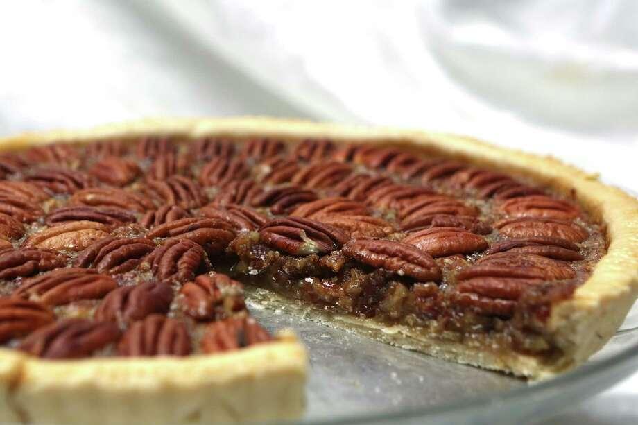 Pecan tart for Taste Thanksgiving story in which Taste writers share their favorite recipes. Photo: Helen L. Montoya, San Antonio Express-News / ©2013 San Antonio Express-News
