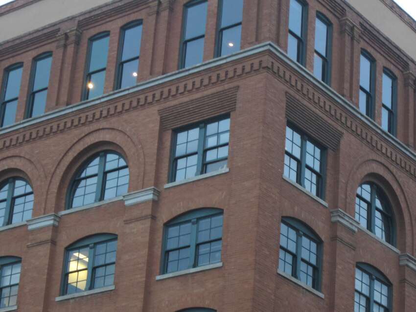The three shots came from the sixth floor window, just below the top floor. left of the corner. The sixth and seventh floors of the former Texas School Book Depository now is the Sixth Floor Museum at Dealey Plaza.
