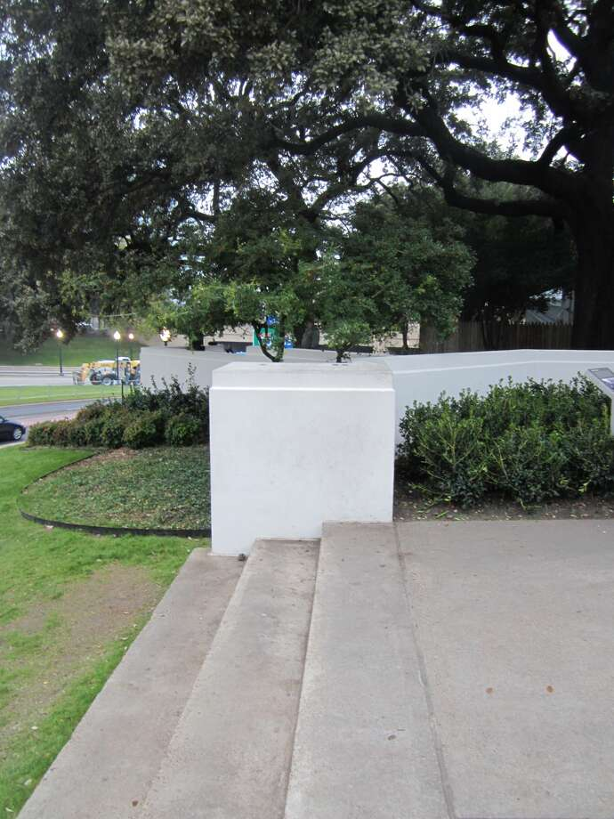 Abraham Zapruder, a Dallas businessman, stood on the pedestal, also called a plinth, that is part of the north pergola in Dealey Plaza, when he filmed President John F. Kennedy's assassination as the motorcade passed by on Nov. 22, 1963. Photo: David Hendricks/San Antonio Express-News