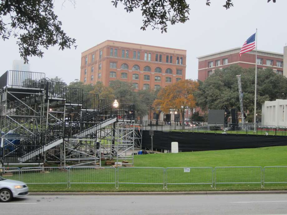 "A riser for broadcasters is positioned in Dealey Plaza in preparations Thursday for a ceremony Friday titled ""The 50th: Honoring the Memory of President John F. Kennedy."" About 5,000 people have tickets to the event. The weather forecast for Friday calls for a high chance of rain and temperatures in the 30s. Photo: David Hendricks/San Antonio Express-News"