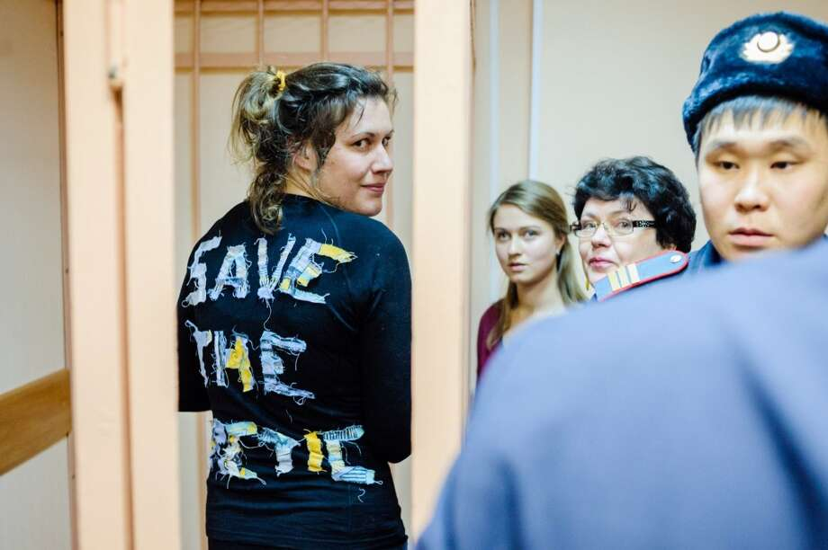 "Greenpeace International activist Anne Mie Roer Jensen (left), from Denmark, wears a t-shirt reading ""Save the arctic"" during a hearing at the Primorskiy Court, in Saint Petersburg. Russia had held 30 crew members of the Arctic Sunrise for over two months after activists in September scaled an oil rig in the Barents Sea owned by energy giant Gazprom. Photo: VLADIMIR BARYSHEV, AFP/Getty Images"