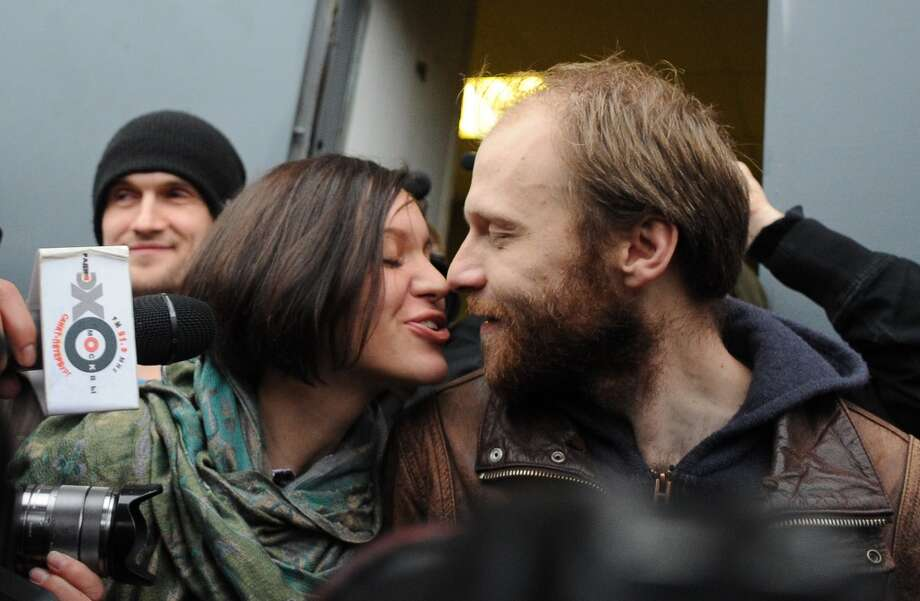 Russian photographer Denis Sinyakov kisses his wife Alina as he is released on bail from SIZO 1 detention centre in Saint Petersburg, on November 21, 2013. A Russian court granted bail to twenty arrested campaigners. Photo: OLGA MALTSEVA, AFP/Getty Images