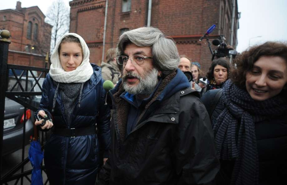 Greenpeace International activist Andrey Allakhverdov (center) walks as he is released on bail from SIZO 1 detention centre in Saint Petersburg, on November 21, 2013. A Russian court granted bail to twenty arrested campaigners. Photo: OLGA MALTSEVA, AFP/Getty Images