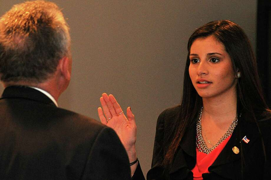 Eloisa Melendez is sworn in as a new member of the Common Council by Mayor Harry Rilling. At 19, she is the youngest member of the city's legislative body in a generation. Photo: Nancy Guenther Chapman / Norwalk Citizen contributed