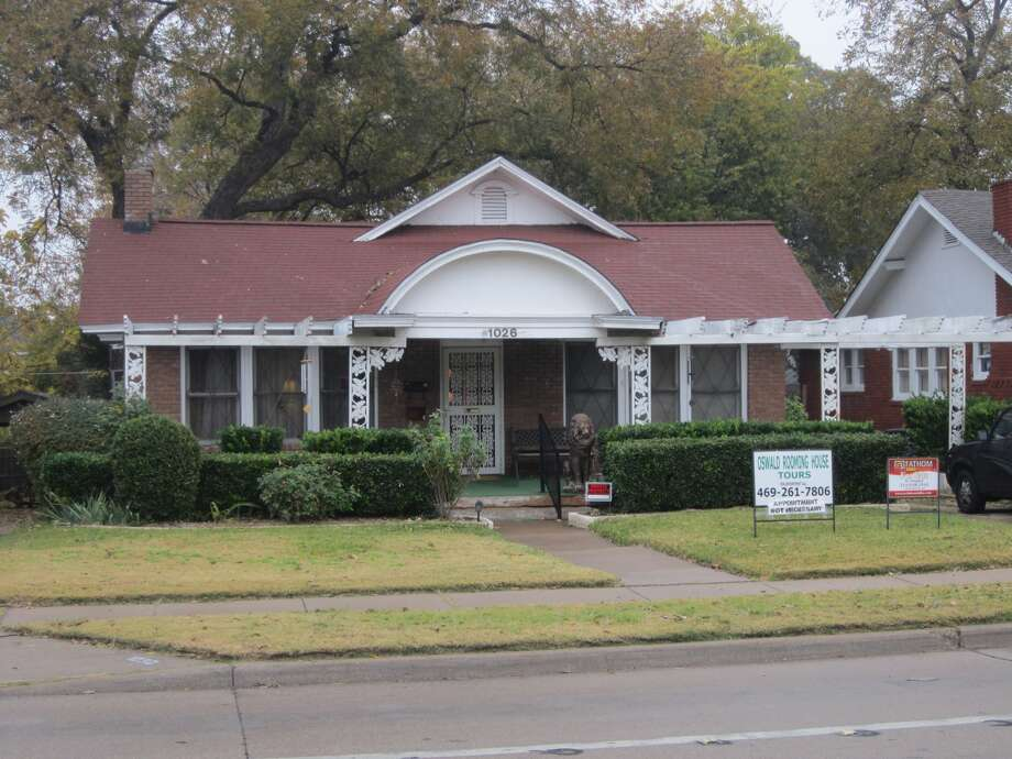 This Oak Cliff house on North Beckley Street is shown as it looked   Thursday. In the weeks before the Kennedy assassination, Lee Harvey   Oswald rented a room in the house. After the Nov. 22, 1963,   shooting, Oswald went to this house to retrieve a handgun and to   put on a jacket. This house is private property, but a sign   Thursday states it is up for sale. Photo: David Hendricks/San Antonio Express-News