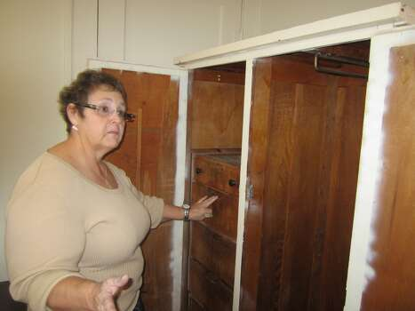 Patricia Puckett-Hall on Thursday shows the drawers from the original wardrobe furniture of Lee Harvey Oswald's room at the North Beckley Street rooming house from which Oswald retrieved his handgun after the Nov. 22, 1963, assassination. Puckett-Hall is the granddaughter of Gladys Johnson, who owned the rooming house at the time. Oswald rented the room for $8 a week while earning $1.25 an hour at his job at the Texas School Book Depository Building. 