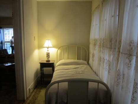 Lee Harvey Oswald's room at the North Beckley Street rooming house was hardly larger than a closet. Shown is the bed, with the original bedframe Oswald used, as displayed Thursday in the rooming house in the Oak Cliff section of Dallas. Photo: David Hendricks/San Antonio Express-News