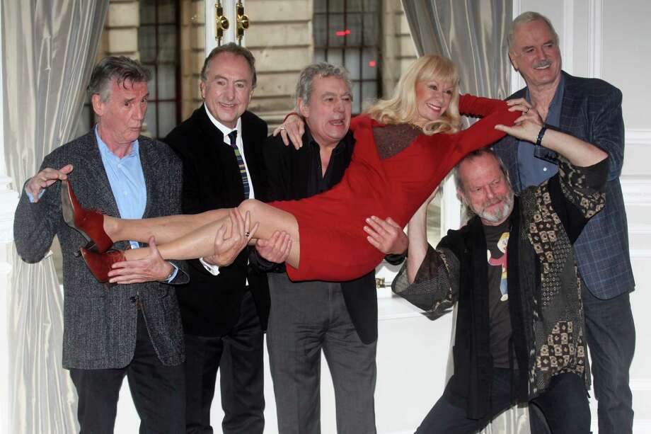 From left: Michael Palin, Eric Idle, Terry Jones, Terry Gilliam, Carol Cleveland and John Cleese of the comedy troop Monty Python are seen at a photo call, on Thursday, Nov. 21, 2013 in London. They are reuniting for a project. (Photo by Jim Ross/InvisionAP Images) ORG XMIT: LDN102 Photo: Jim Ross / Invision