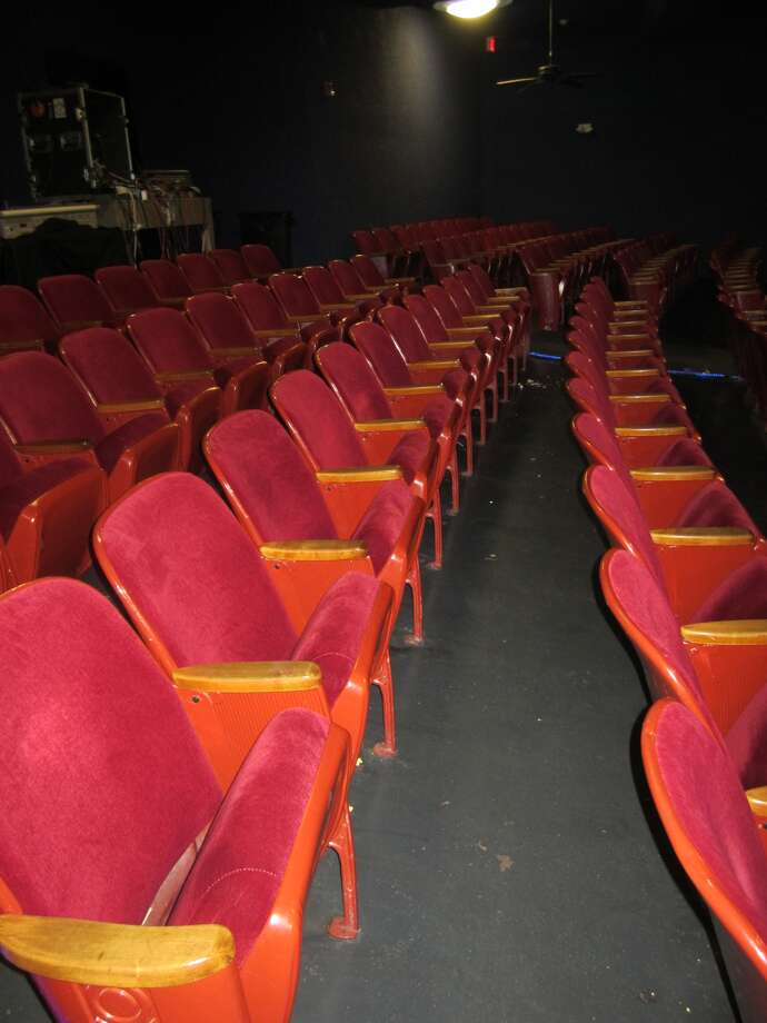 "Lee Harvey Oswald sat in the third row from the back inside the Texas Theater, fifth seat in, when Dallas Police officers entered the theater to arrest him. He then moved to the second seat in, which is where he was spotted and arrested after a scuffle with police officers. The red seats shown in the photo, taken Thursday, are not the same seats used 50 years ago, which were long ago replaced. On Friday, the 50th anniversary of the Kennedy assassination and Oswald's arrest, the theater will show about half of ""War Is Hell,"" the movie that was being shown when Oswald slipped into the theater. Only 40 minutes of the 121-minute movie survives. The aging theater, built in 1931, will charge 90 cents for admission for the event Friday. 