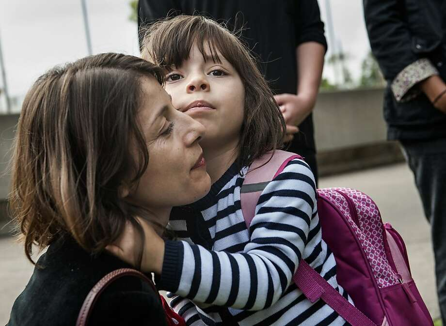 Norma Esparza, hugged by daughter Arianna, says her case sends a chilling message to sex abuse victims. Photo: Bruce Chambers, Associated Press