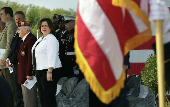 A reader applauds the decision by the Daughters of the Republic of Texas to accept Sen. Leticia Van de Putte, shown here as the colors are presented at the recent Veterans Day ceremony at Fort Sam Houston National Cemetery. Photo: Bob Owen / San Antonio Express-News