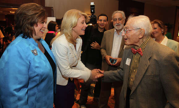 State Senators Leticia Van de Putte (left) and Wendy Davis (center) greet Bill Sinkin (right) Monday November 4, 2013 at the Marriott Rivercenter before an Annie's List luncheon. Davis is the Democratic candidate for Texas governor. Photo: SAN ANTONIO EXPRESS-NEWS / ©San Antonio Express-News/Photo may be sold to the public