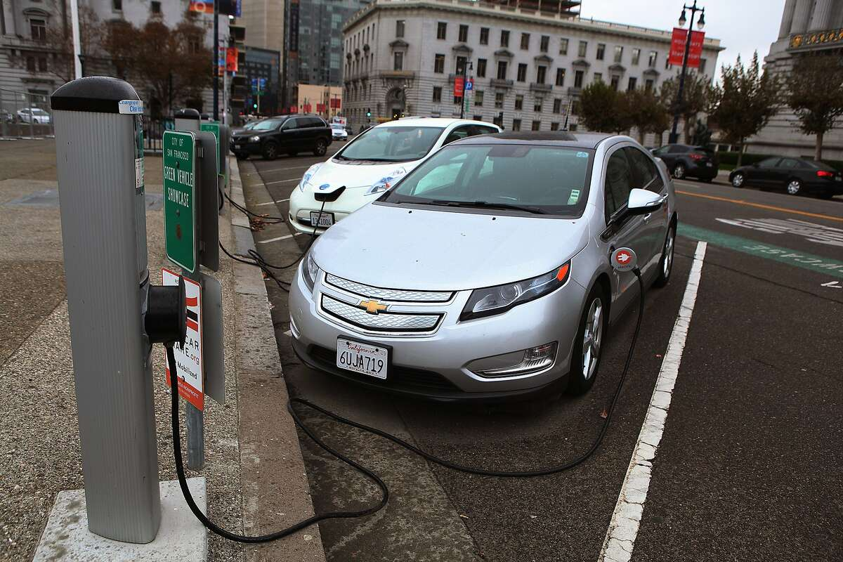 Electric cars use a charging station with level 2 chargers on Polk Street across from City Hall in San Francisco, California, on Tuesday, November 19, 2013.