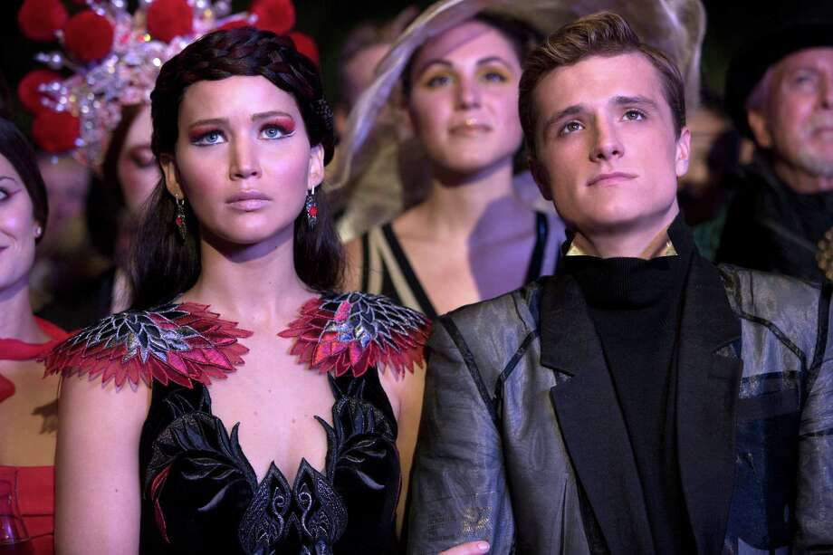"Katniss Everdeen (Jennifer Lawrence, left) and Peeta Mellark (Josh Hutcherson) have returned home as ""The Hunger Games: Catching Fire"" opens. Photo: Murray Close, HOEP / Lionsgate"
