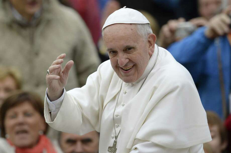 Pope Francis greets the crowd as he arrives for his general audience at St Peter's square on November 20, 2013 at the Vatican.  AFP PHOTO / ANDREAS SOLAROANDREAS SOLARO/AFP/Getty Images Photo: ANDREAS SOLARO, Staff / AFP