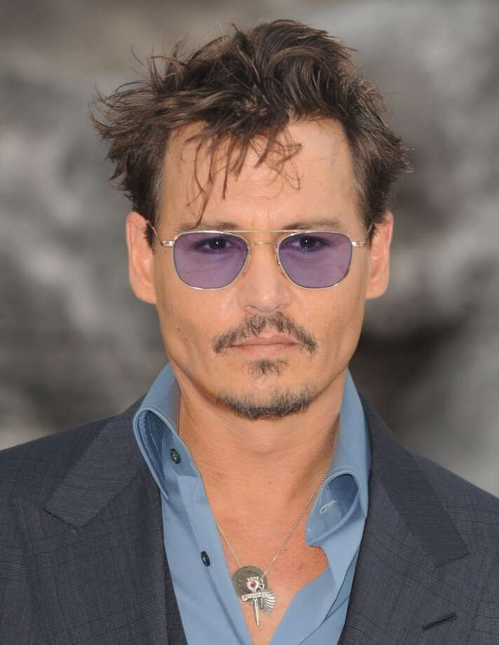 """Johnny Deep turned 50 on June 9.  He's pictured at the London premiere of """"The Lone Ranger"""" on July 21, 2013. Photo: Ferdaus Shamim, WireImage"""
