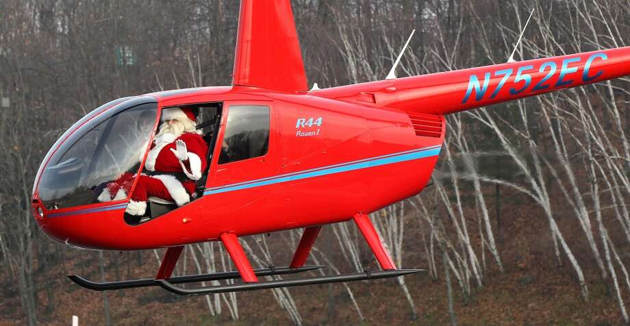 Stow, MassachusettsThis New England Santa arrives in style via a Santacopter. Photo: Boston Globe, Boston Globe Via Getty Images
