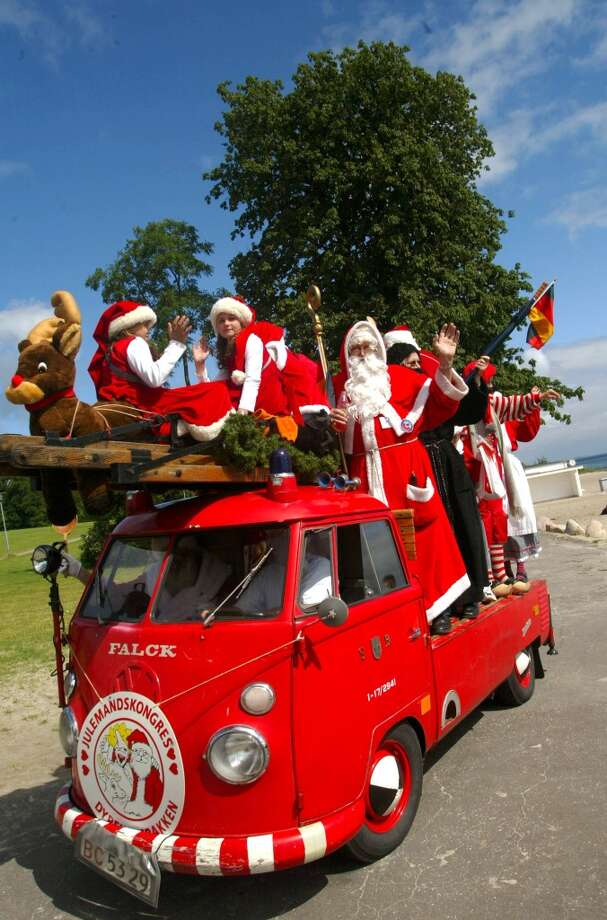 Copenhagen, DenmarkA group of Santas ride a minibus in a 2002 parade in Denmark. Photo: Sion Touhig, Getty Images