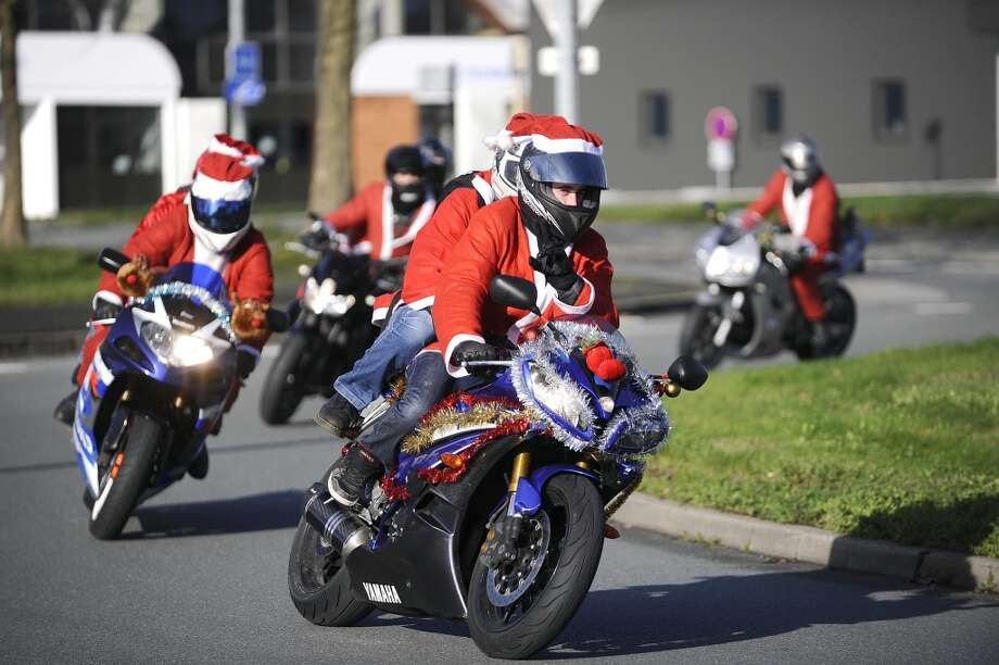 La Roche-Sur-Yon, FranceThese French Santas hit the streets on motorcycles in a 2011 parade event in La Roche-Sur-Yon. Photo: AFP, AFP/Getty Images