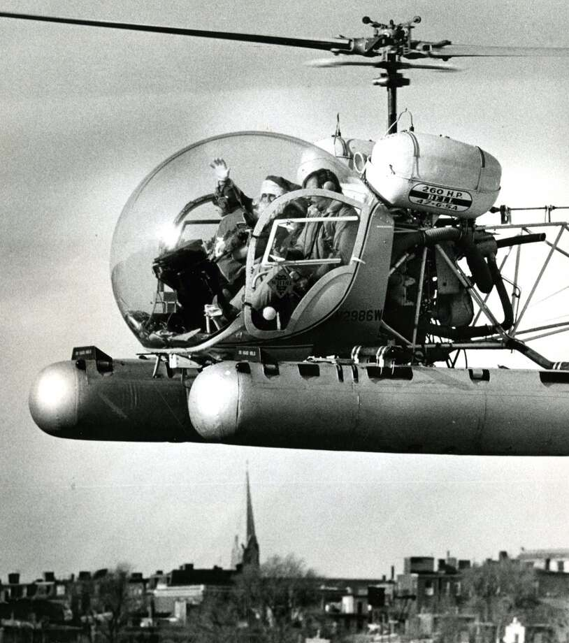 Boston, MassachusettsThis Boston Santa arrives in a helicopter for the North End holiday parade in 1979. Photo: Boston Globe, Boston Globe Via Getty Images