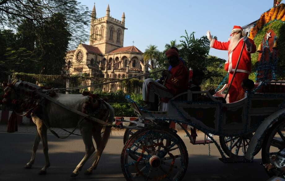 Allahabad, IndiaThis 2009 parade in India was led by a Santa in a horse-drawn carriage. Photo: DIPTENDU DUTTA, AFP/Getty Images