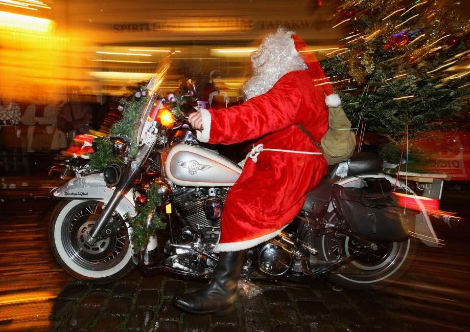 Berlin, GermanyThis German Santa took to two wheels for a 2009 parade in Berlin. Photo: Andreas Rentz, Getty Images