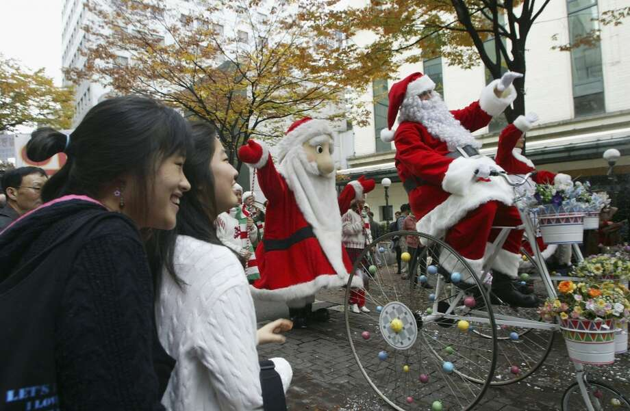 Seoul, South KoreaThis South Korean Santa got in touch with their inner child on this over-sized tricycle in 2004. Photo: Chung Sung-Jun, Getty Images