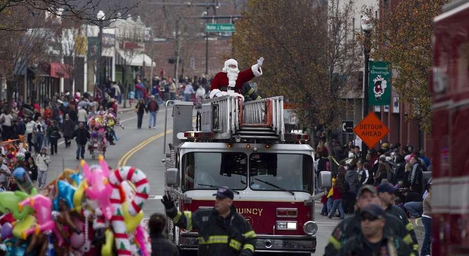 Boston, MassachusettsThis Boston Santa sticks to the classic fire truck ride at the end of a 2011 parade. Photo: Boston Globe, Boston Globe Via Getty Images