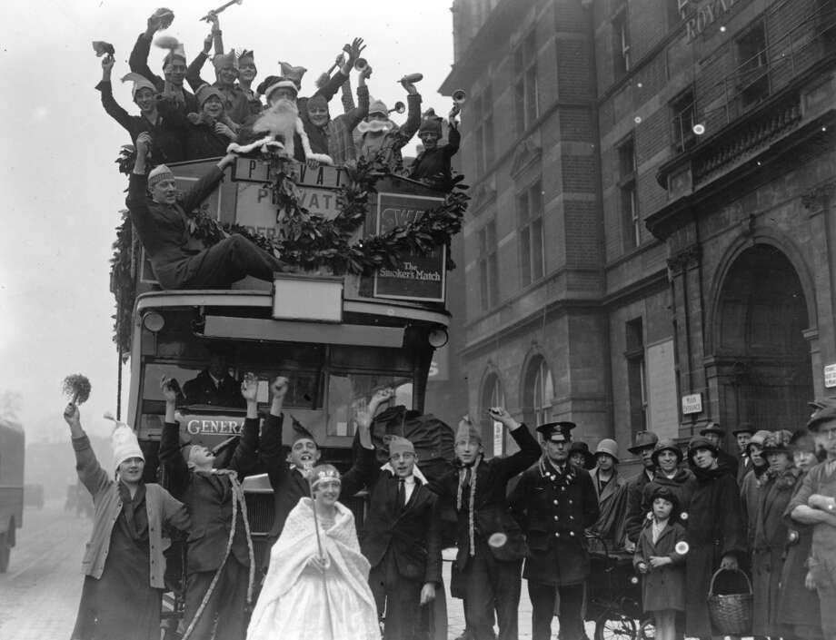London, EnglandEven Santa couldn't resist a ride on the classic doubledecker bus in this 1926 London parade. Photo: Fox Photos, Getty Images