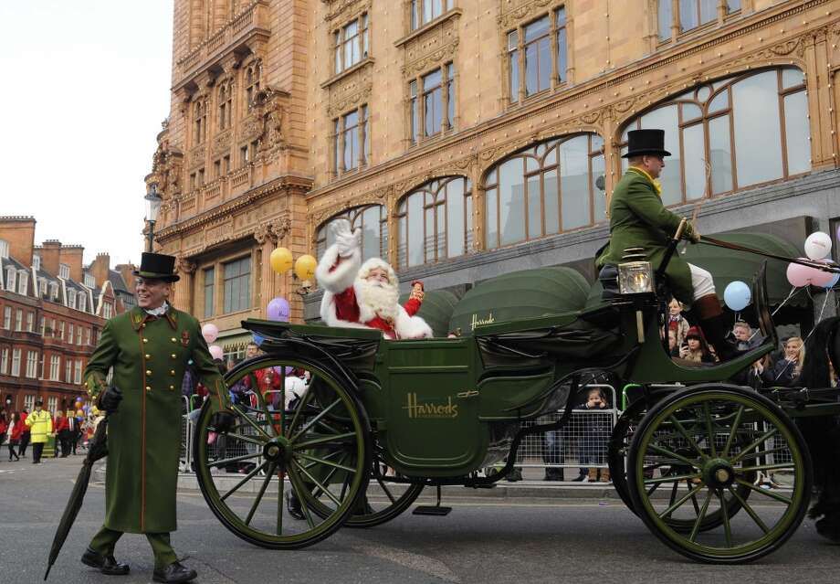 London, EnglandFather Christmas waves to the crowd from a buggy in a 2013 holiday parade. Photo: Harrods, Getty Images