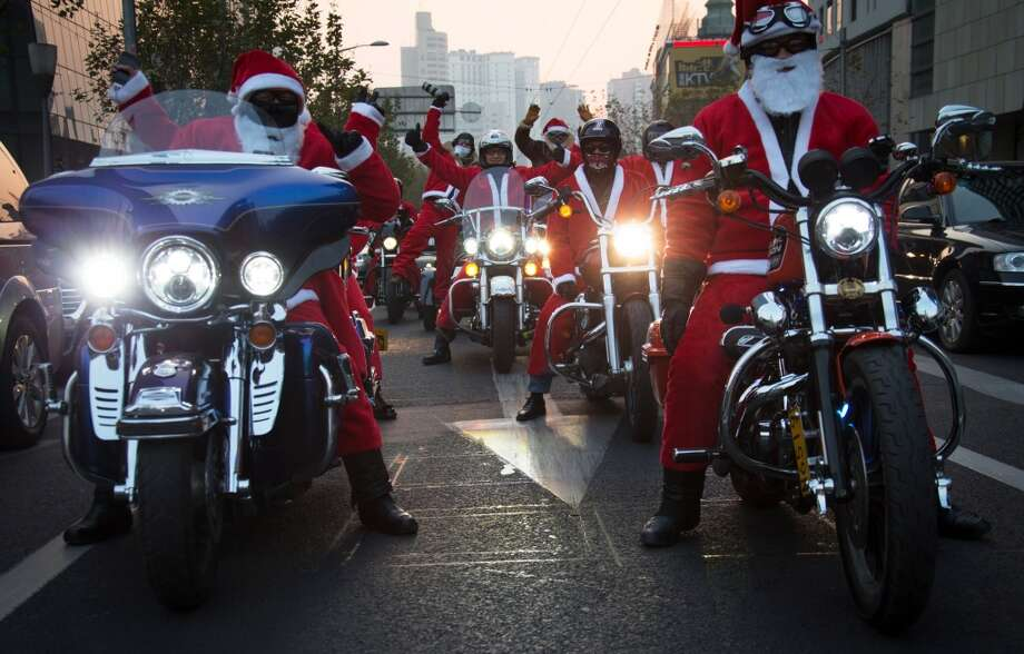 Shanghai, ChinaThese Santas were hittng the parade route on two wheels in a 2012 parade in Shanghai. Photo: ChinaFotoPress, ChinaFotoPress Via Getty Images