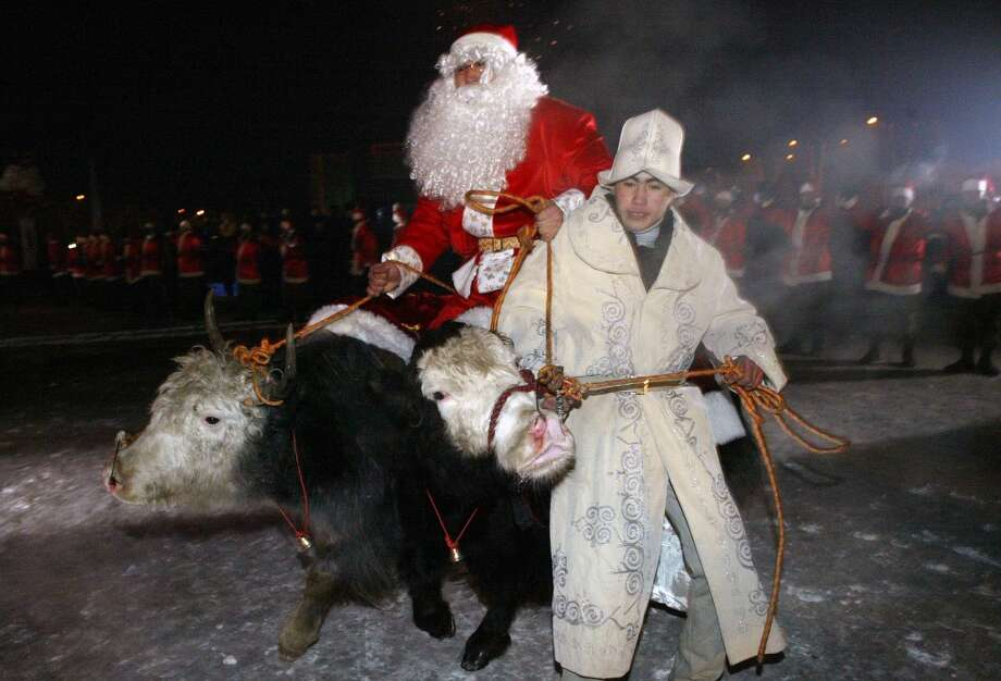 Bishkek, KyrgyzstanThis Santa opts for a bull during a 2007 Bishkek parade. Photo: VYACHESLAV OSELEDKO, AFP/Getty Images