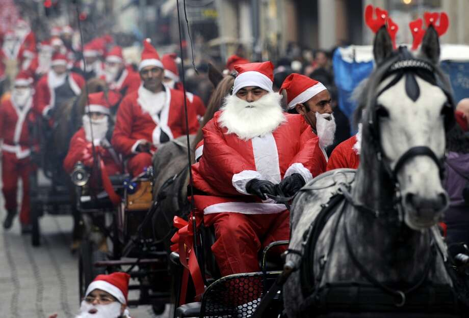 Porto, SpainThis 2009 holiday parade in Porto attempted to break the Guinness world record of 14,000 Santas, with the lead Santa riding in a horse-drawn cart. Photo: AFP, AFP/Getty Images