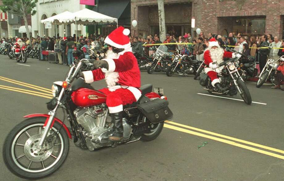 Los Angeles, CaliforniaSanta took a spin on a motorcycle in this 1994 LA parade. Photo: CARLOS SCHIEBECK, AFP/Getty Images