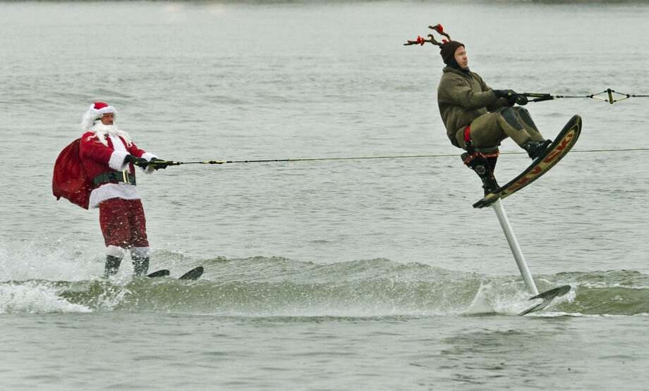 "Washington, DCA water-skiing Santa and his ""reindeer"" cruise along the Potomac River in the 2012 Annual Water Skiing show. The event features a water-skiing Santa, flying elves, the Jet-skiing Grinch, and Frosty the Snowman performing on the Potomac River. Photo: PAUL J. RICHARDS, AFP/Getty Images"