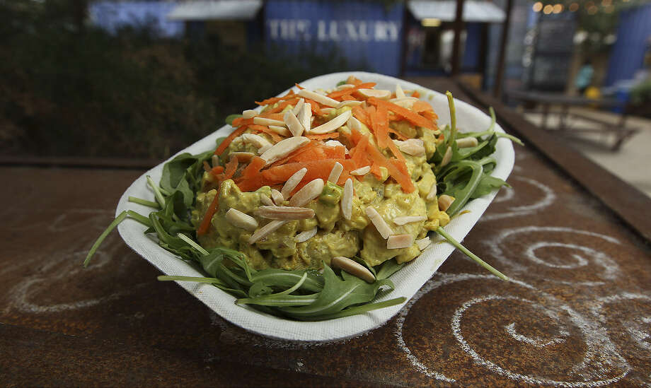 The Chicken Curry at The Luxury artfully balances tart and sweet flavors. Photo: Kin Man Hui / San Antonio Express-News