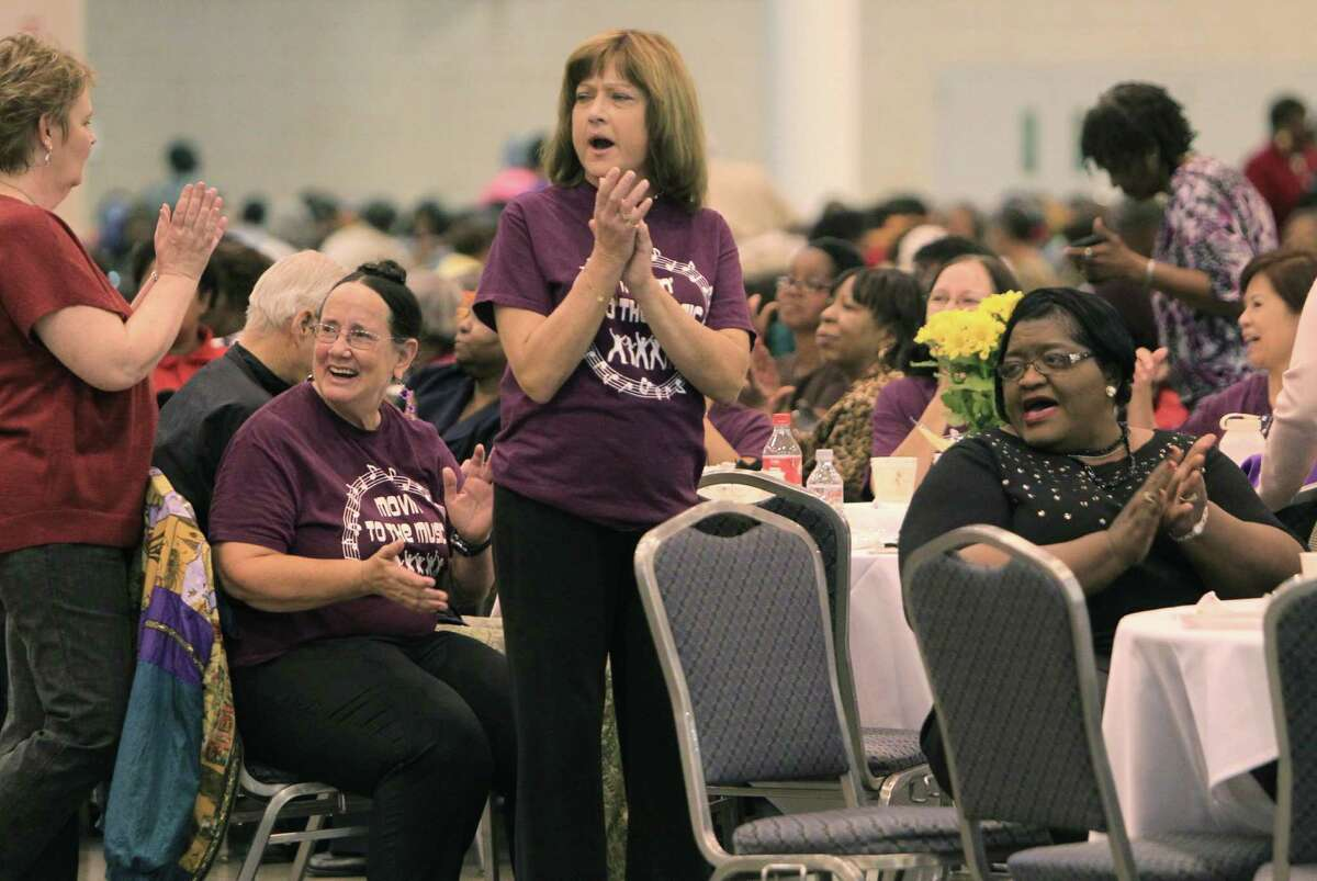 Seniors clap for dancers upon the end of a song during the Seniors Holiday Celebration at Reliant Center on Thursday, Nov. 21, 2013, in Houston. The Harris County Precinct One sponsored event attracted 3,500 who lined danced, ate dinner, and contributed to a food drive for the homeless.
