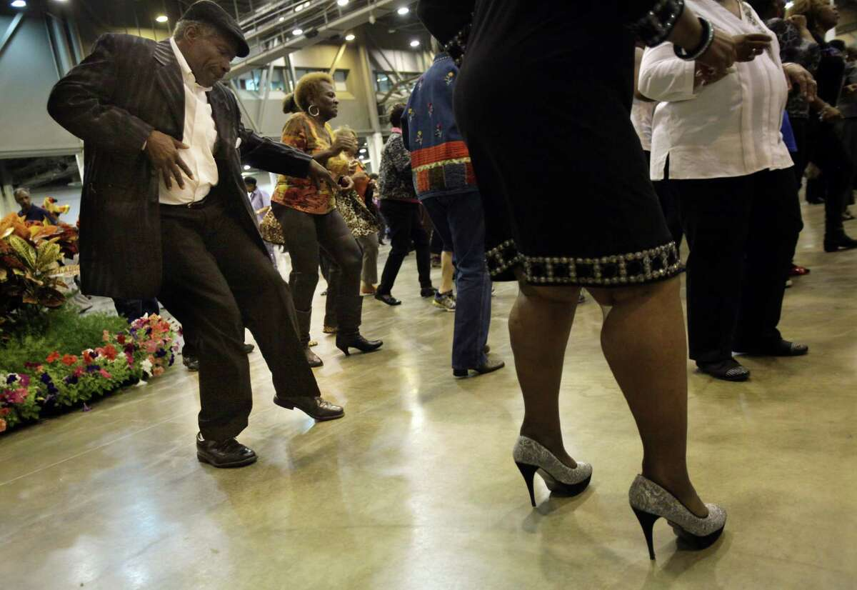 Anthony Willis, 57, dances with Dorothy Edwards, 68, during the Seniors Holiday Celebration at Reliant Center on Thursday, Nov. 21, 2013, in Houston. The Harris County Precinct One sponsored event attracted 3,500 who lined danced, ate dinner, and contributed to a food drive for the homeless.