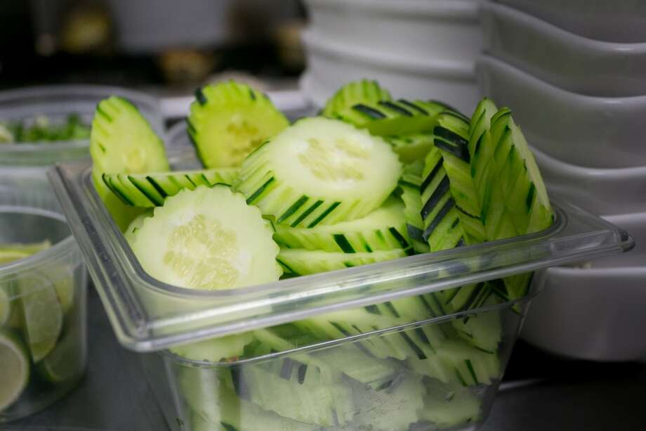 Cut cucumbers in the kitchen at Champa Garden in San Francisco. Photo: John Storey, Special To The Chronicle