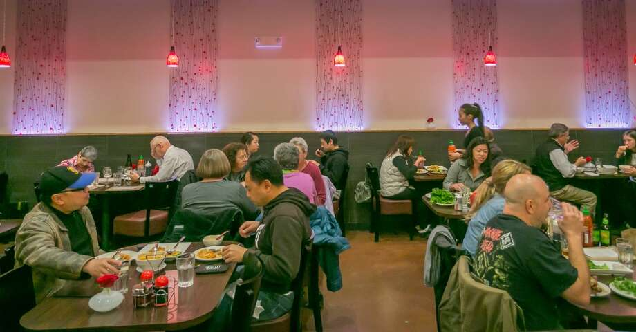 Diners enjoy dinner at Champa Garden in San Francisco. Photo: John Storey, Special To The Chronicle