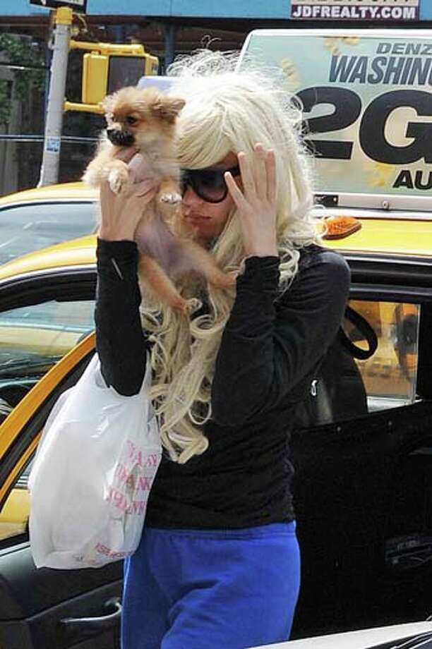 Amanda Bynes arrives for a court appearance, in New York, Tuesday, July 9, 2013. The 27-year-old actress is charged with reckless endangerment and attempted tampering with physical evidence. Bynes was arrested in May after building officials called police to complain she was smoking pot in the lobby. Officers went to her apartment where they say they saw a bong sitting on the kitchen counter. Prosecutors say she tossed the bong out the window in front of the officers. Photo: NCP/Star Max, FilmMagic / 2013 Star Max