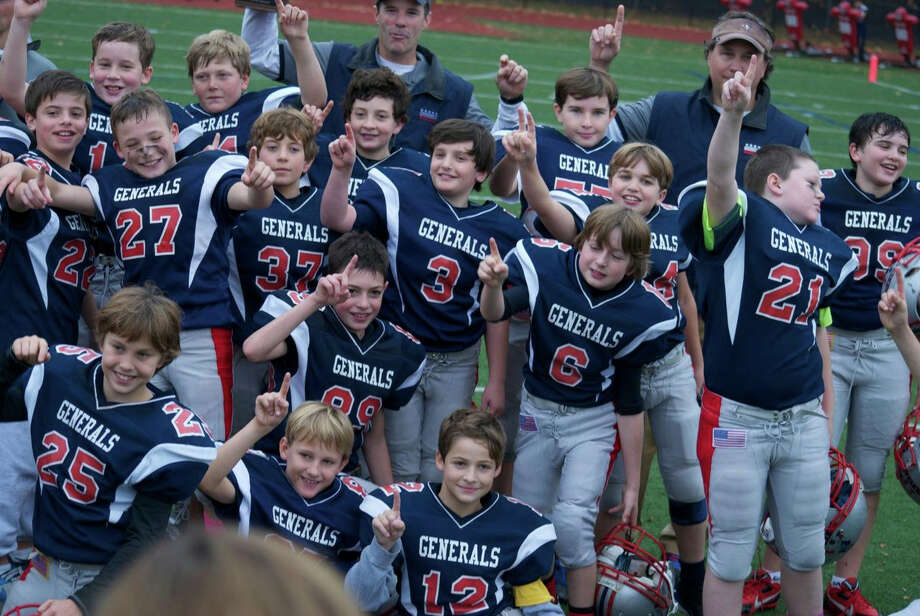 The Putnam Generals celebrate the GYFL Junior championship. November 2013. Photo: Contributed Photo / Stamford Advocate Contributed