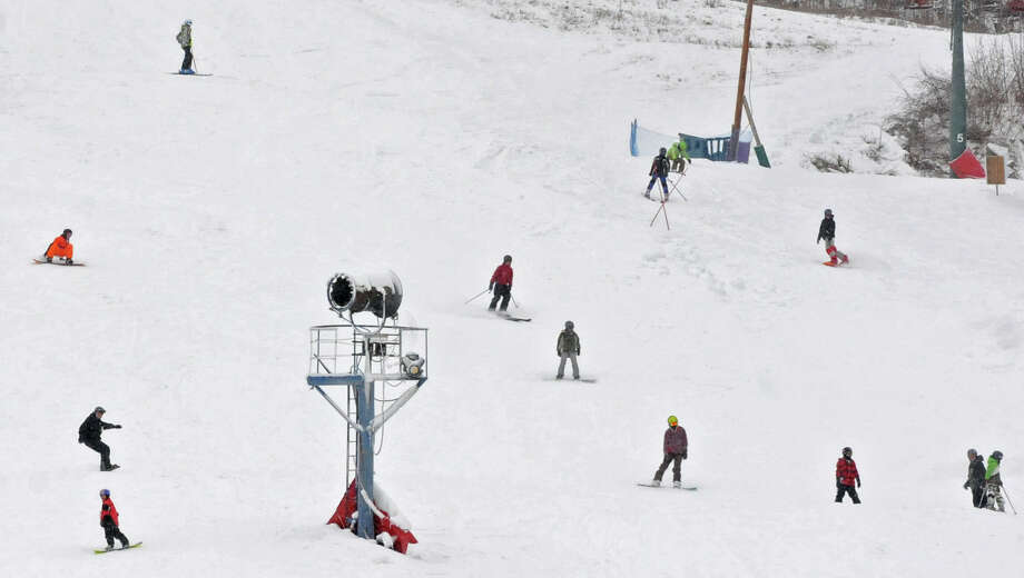 Snowboarders and skiers take advantage of the snowy weather at West Mountain ski area on Friday Feb. 8, 2013 in Glens Falls, N.Y. (Lori Van Buren / Times Union) Photo: Lori Van Buren / 00021096A