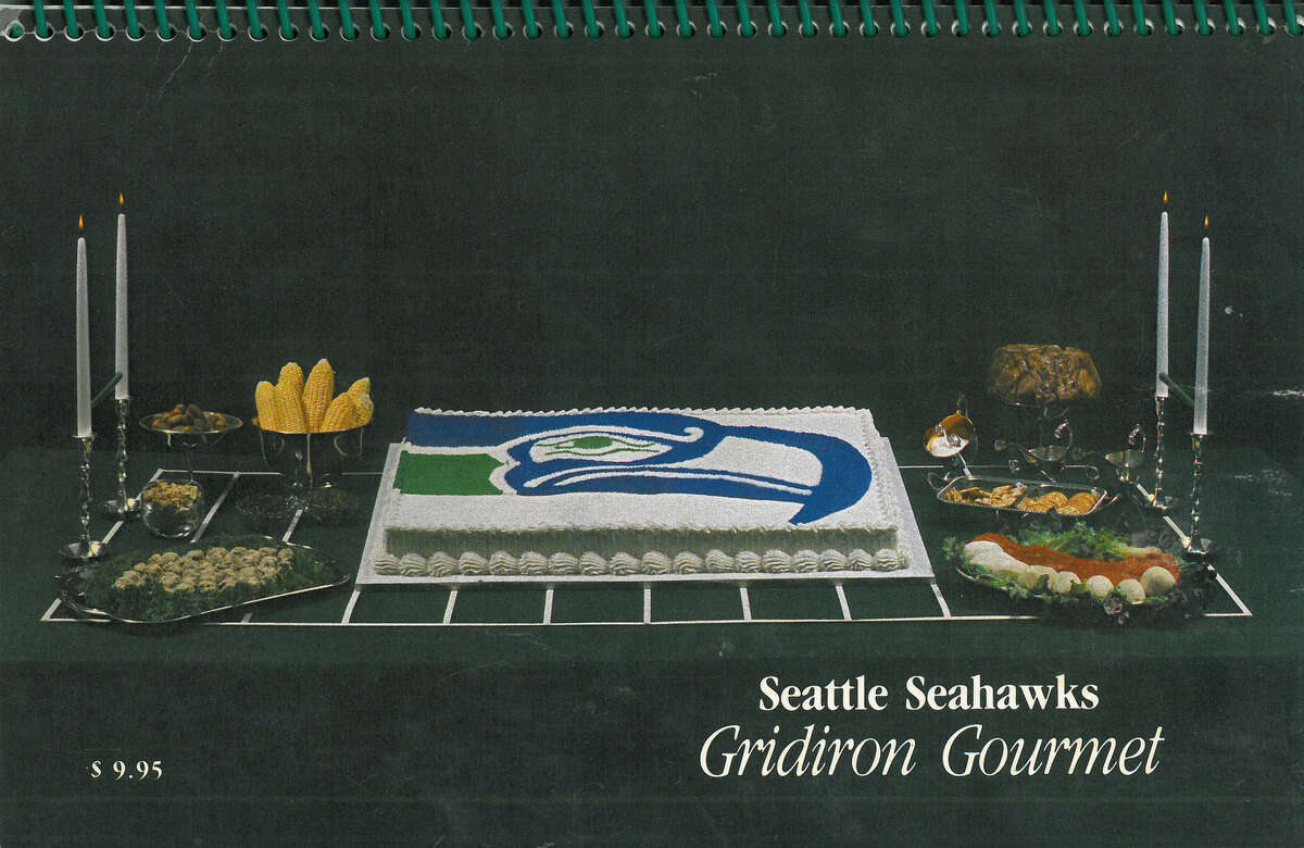 The original cookbook is oriented vertically, which made the photos and text much too small to read when displayed in our photo gallery. As such, we decided to split up each page into two. In the slides that follow, each photo of a Seahawks player and his family precedes the favorite recipe they submitted. Enjoy!This cookbook is republished in its entirety with permission from the Seattle Seahawks.