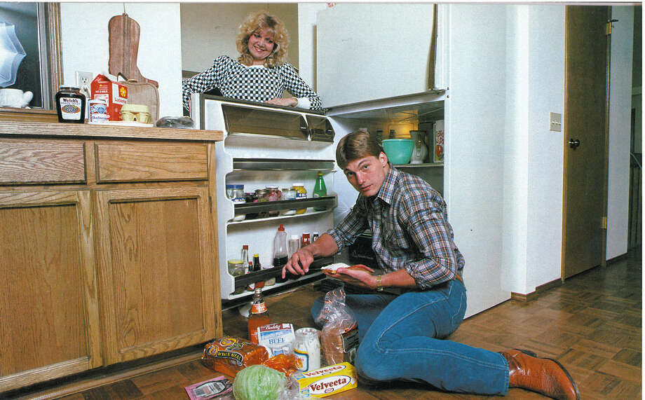 Linebacker Bruce Scholtz is pictured with his wife, Janelle, and their well-stocked refrigerator. Photo: Corky Trewin/Seattle Seahawks