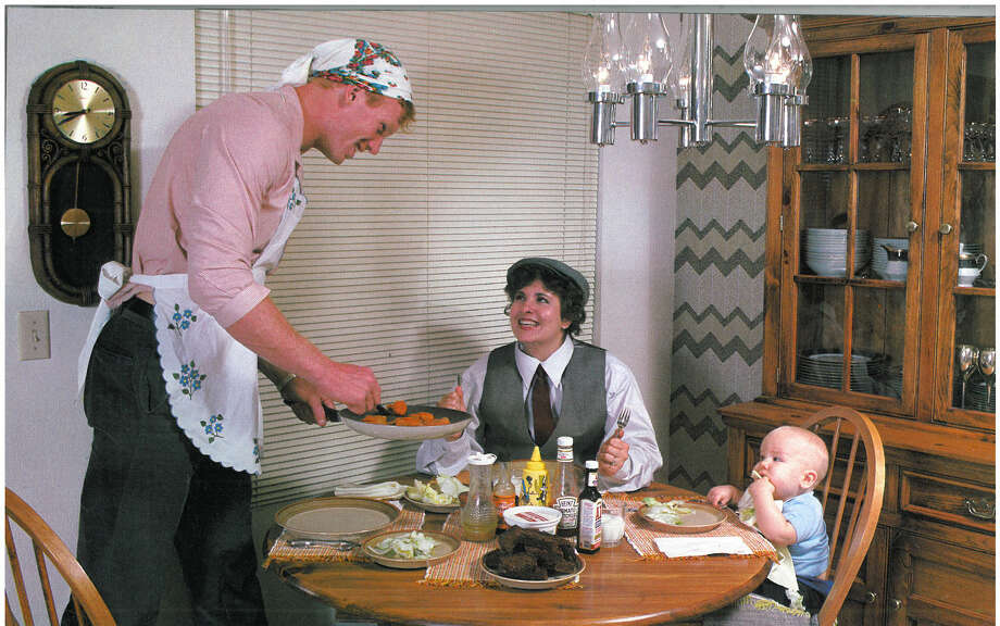 Tight end Pete Metzelaars is pictured with his wife, Barb, and their infant child. Photo: Corky Trewin/Seattle Seahawks